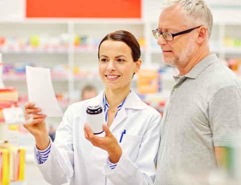 pharmacist showing a medicine to her customer