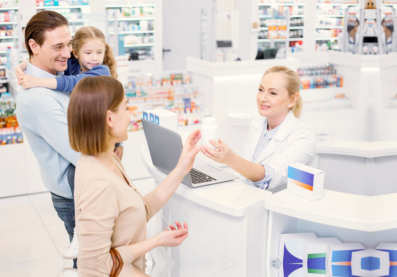 family buying medicine at a drug store
